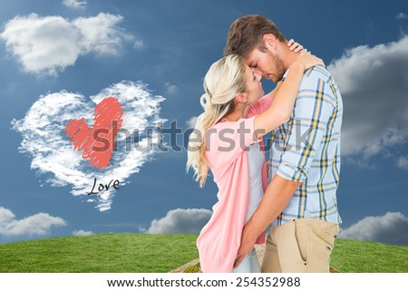 Attractive young couple about to kiss against cloud heart - stock photo