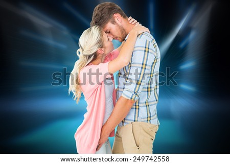 Attractive young couple about to kiss against cool nightlife lights - stock photo