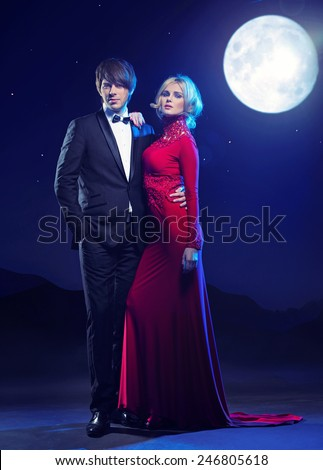 Attractive young couple at evening - stock photo