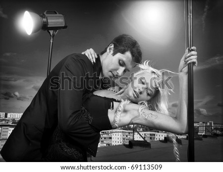 attractive young couple embraced on a background of sky - stock photo