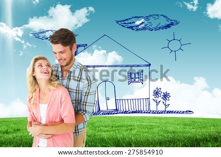 Attractive young couple embracing and smiling against blue sky over green field - stock photo