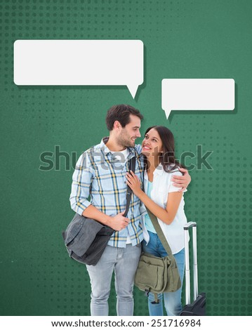 Attractive young couple going on their holidays against green - stock photo