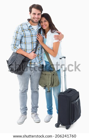 Attractive young couple going on their holidays on white background - stock photo