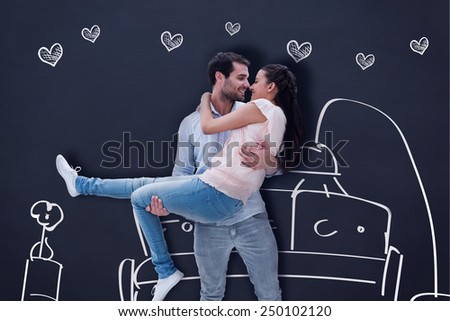 Attractive young couple having fun against blackboard - stock photo