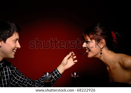 Attractive young couple having romantic dinner