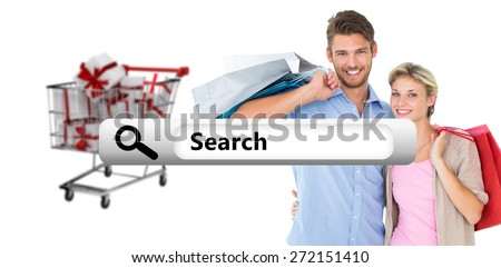 Attractive young couple holding shopping bags against search engine - stock photo