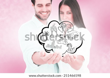 Attractive young couple holding their hands out against pink vignette - stock photo