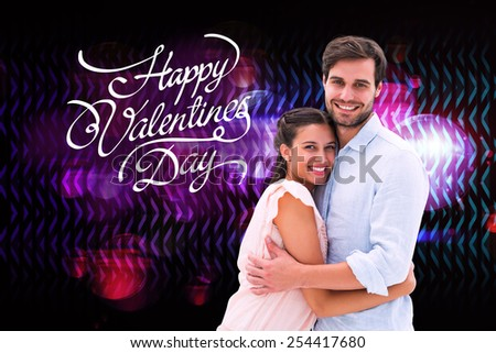 Attractive young couple hugging and smiling at camera against digitally generated cool disco design - stock photo