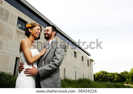 Attractive young couple in formal wear laughing