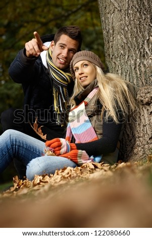 Attractive young couple in park at autumn.