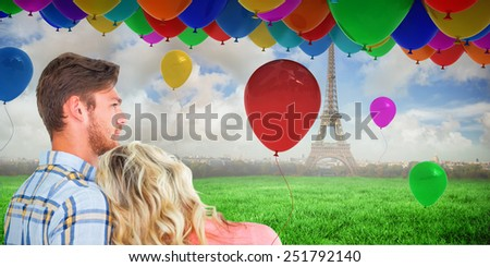 Attractive young couple looking together against eiffel tower - stock photo