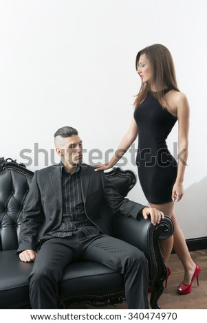 Attractive young couple, man in business suit and woman in dress