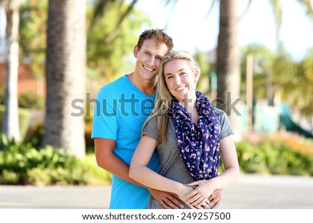 Attractive young couple on a bright sunny day - stock photo