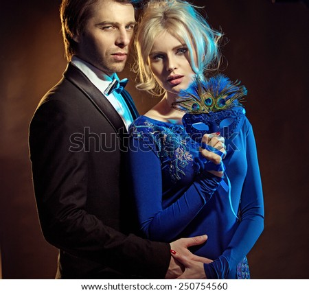 Attractive young couple posing - stock photo