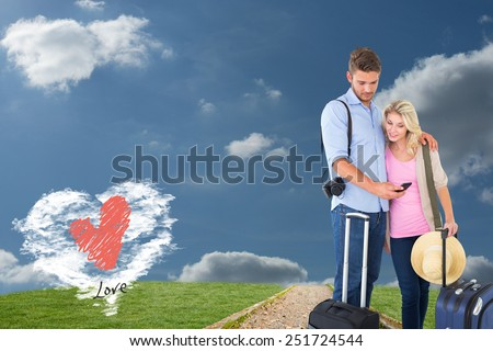 Attractive young couple ready to go on vacation against cloud heart - stock photo