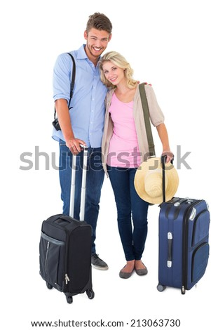 Attractive young couple ready to go on vacation on white background - stock photo