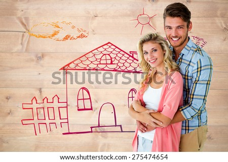 Attractive young couple smiling at camera against bleached wooden planks background - stock photo