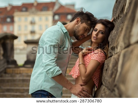 Attractive young couple touching each other - stock photo