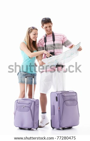 Attractive young couple with  suitcases looking map isolated