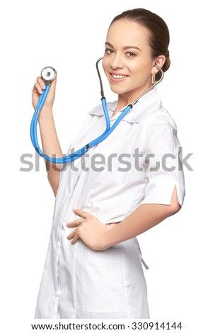 Attractive young doctor with stethoscope holding folder and looking at camera