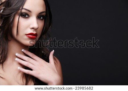 Attractive young fashion model posing in black dress. - stock photo