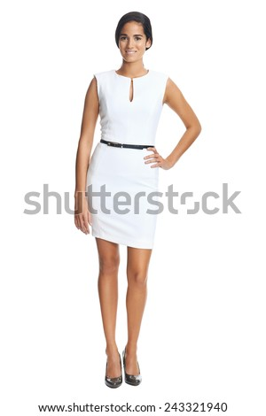 Attractive young fashion model wears a business dress in studio and smiling - stock photo