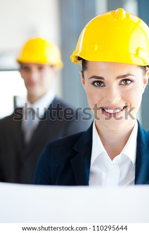 attractive young female architect closeup portrait - stock photo