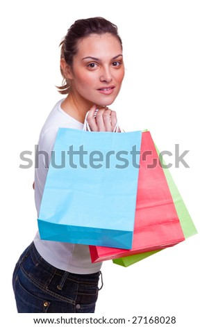 Attractive young female carrying colourful blank shopping bags over her shoulder, isolated on white background. - stock photo