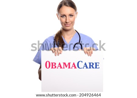 Attractive young female doctor, veterinarian or nurse holding a white placard in her hands with obamacare written on it, isolated on white - stock photo