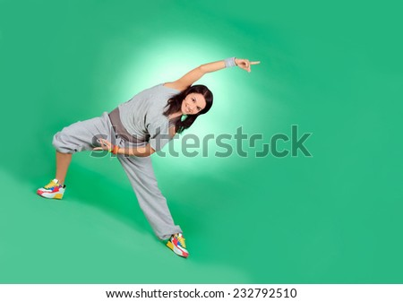 Attractive young female in stretching over green - stock photo