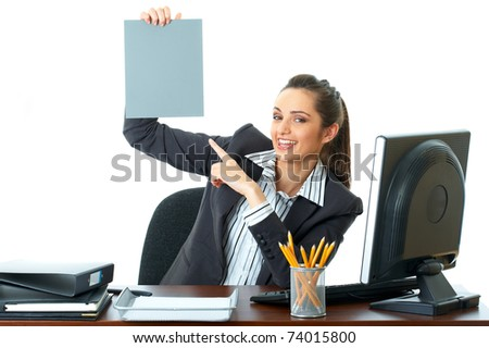 attractive young female office worker holds empty grey card in front of her, isolated on white background