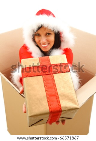 Attractive young female Santa offering a gift to us from a big box