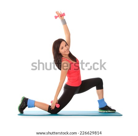 Attractive young female with fitness dumbbells in stretching - stock photo