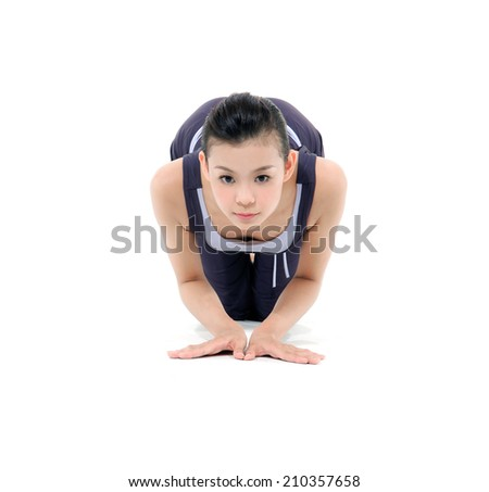 Attractive young girl doing yoga exercises isolated on white background - stock photo