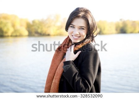 Attractive young girl in a park in autumn