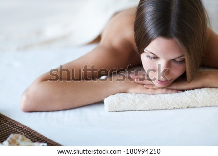 Attractive young girl in spa salon