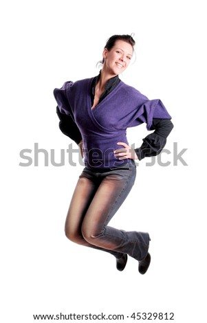 attractive young girl jumping in the air - stock photo