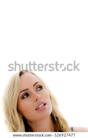 Attractive Young Girl Looking Up as if Reading or Promoting a Service or Product Against a White Background