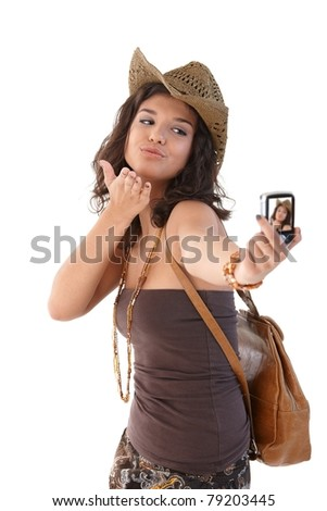 Attractive young girl photographing herself, smiling.?