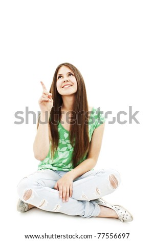 Attractive young girl pointing with finger. All on white background.