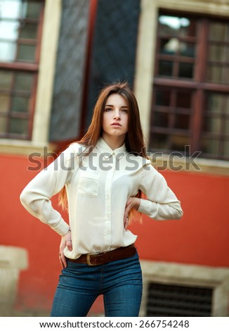 Attractive young girl posing on street of the old city summer day - stock photo