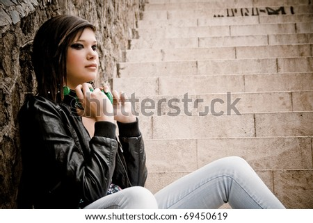 Attractive young girl taking off the headset