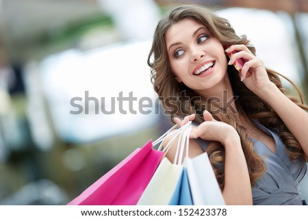 Attractive young girl talking on the phone - stock photo