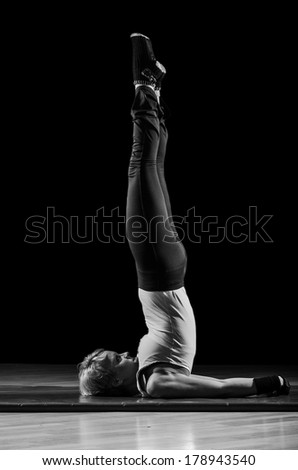 Attractive young girl training yoga, black and white image