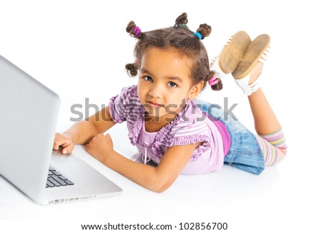 Attractive young girl using notebook computer. Isolated on white background. - stock photo