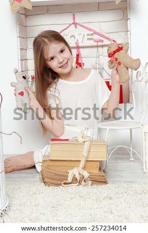 Attractive young girl wearing white dress over beautiful interior on St.Valentine holiday theme - stock photo