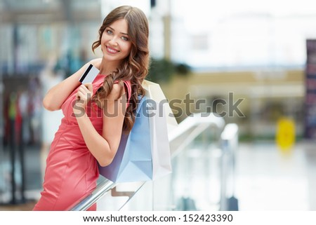 Attractive young girl with a credit card - stock photo