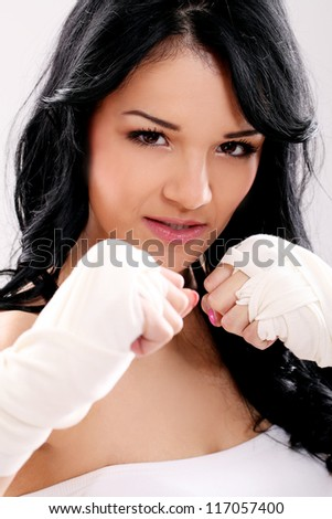 Attractive young girl with bandages ready for fight