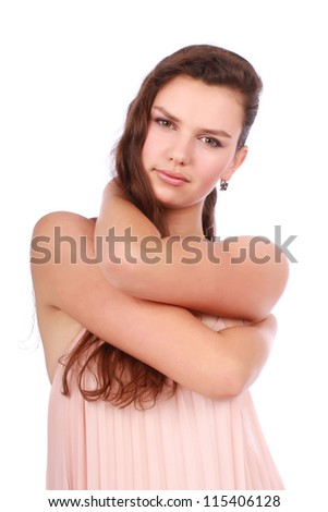 Attractive young girl with her hands over neck isolated on white background - stock photo