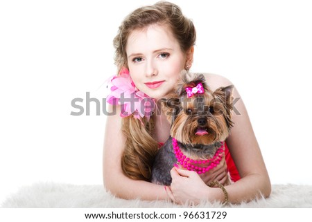 attractive young girl with long blonde hair wearing red dress with yorkshire terrier on isolated white background